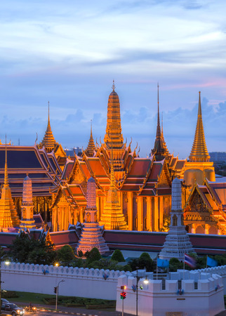 kaew: The beauty of the Emerald Buddha Temple at twilight. And while the gold of the temple catching the light. This is an important buddhist temple of thailand and a famous tourist destination.