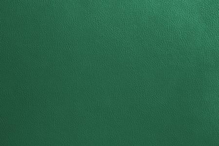 Close-updetail van de groene achtergrond van de leertextuur. Stockfoto