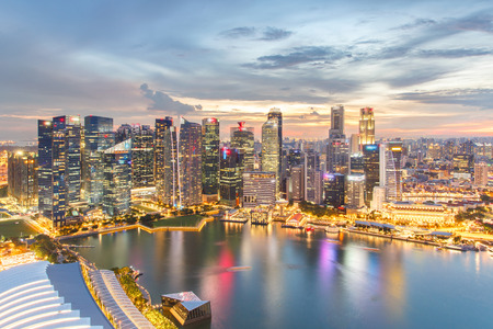 penthouse: Colorful lights architecture business building and financial district in sunset time at Singapore City. Stock Photo