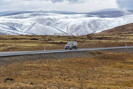 Van car on the road, Beautiful winter road in Tibet under snow mountain Sichuan, China Reklamní fotografie