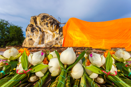 Close up lotus and flower for pray big reclining buddha statue at Wat Lokayasutharam, Ayutthaya Province, Thailand Stock Photo