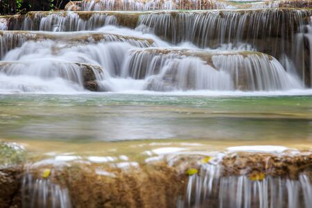 Close up movement waterfall in deep forest at Huai Mae Khamin Waterfall, Amphoe Si Sawat, Kanchanaburi Province, Thailand