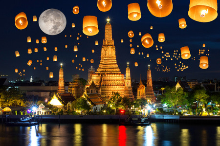 Floating lamp in yee peng festival under loy krathong day at wat arun, Full moon at night in bangkok city, Thailand Stock Photo