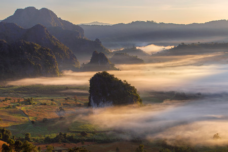 Beautiful Sunrise of travel place with morning mist at Phu Langka National Park in Phayao Province, Thailand Stock Photo