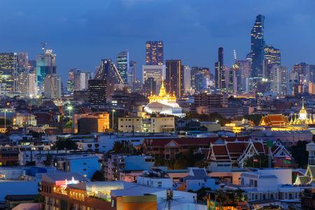 Bangkok city skyline with Wat Saket at night. Editorial
