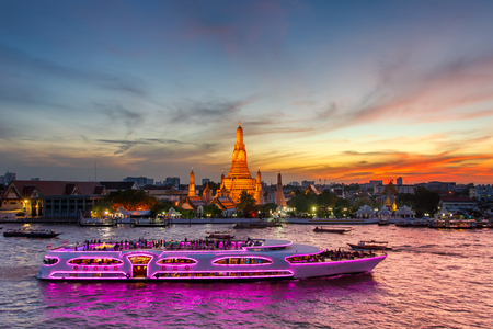 Wat Arun and cruise ship in twilight time, Bangkok city,Thailand