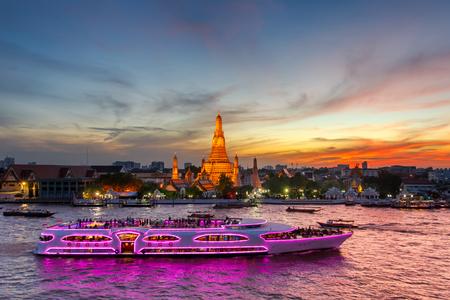 Wat Arun and cruise ship in twilight time, Bangkok city,Thailand
