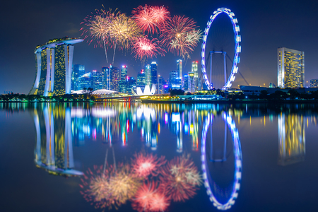 SINGAPORE - APRIL 23, 2017: Beautiful firework over central business district building of Singapore city at night Editorial