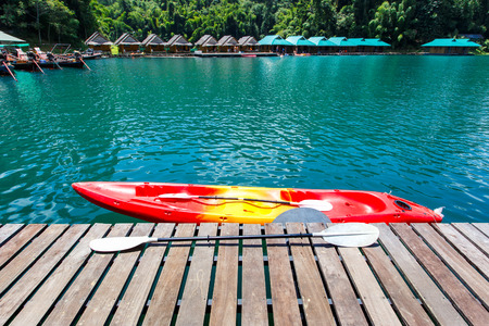 Canoe in a beautiful mountains lake forest and river natural attractions in Ratchaprapha Dam at Khao Sok National Park, Surat Thani Province, Thailand. Stock Photo