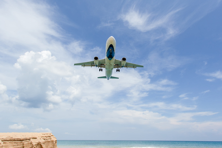 Landing aircraft above the beach at Phuket Airport. Mai Khao beach, one of the most popular beaches among tourists in Phuket. Imagens