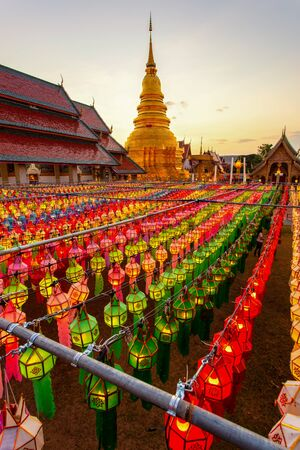 Colorful Lamp Festival and Lantern in Loi Krathong at Wat Phra That Hariphunchai, Lamphun Province, Thailand Imagens