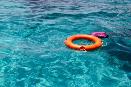 Lifebuoy and Life jacket resting on top of blue waters at Mu Koh Surin National Park, Phangnga Province, Thailand