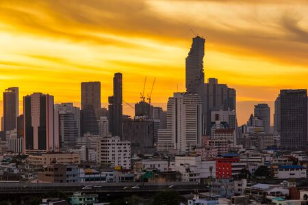 Aerial view modern office buildings in Bangkok city downtown with sunrise time, Bangkok Province, Thailand Standard-Bild