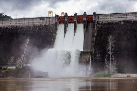 Water flowing over floodgates of a dam at Khun Dan Prakan Chon, Nakhon Nayok Province, Thailand