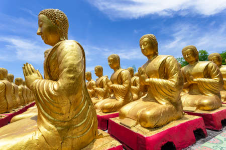 Golden Buddha with 1250 disciples statue at Makha Bucha Buddhist memorial park is built on the occasion of Great period, Nakhon Nayok, Thailand