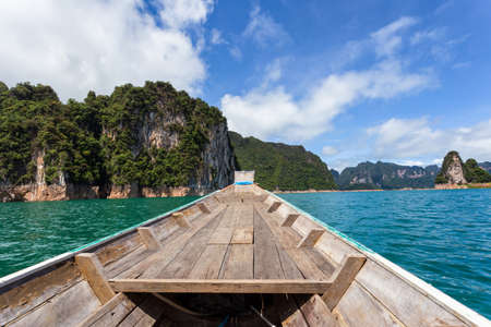 Traditional longtail boat with beautiful scenery view in Ratchaprapha Dam at Khao Sok National Park, Surat Thani Province, Thailand.