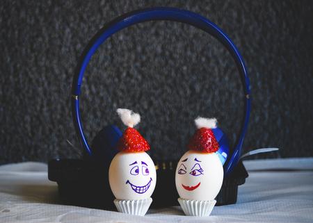 Easter eggs in christmas mood listening music to headphone