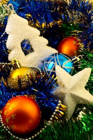 Composition of Christmas balls, star and Christmas trees photo