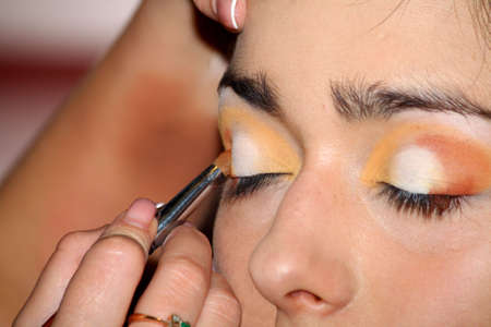 Imposing of a make-up in a beauty salon of beauty in view of a modern fashion