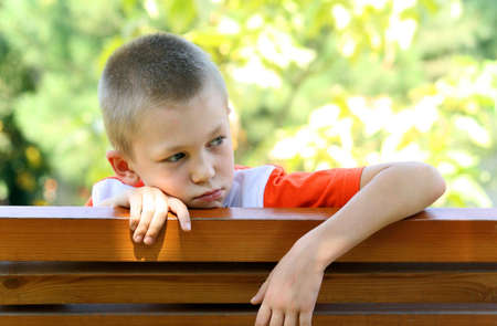 naivety: Sight of the boy at a bench Stock Photo