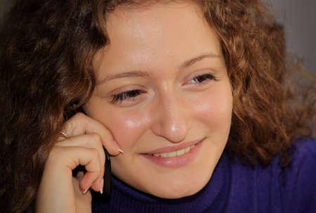 Beautiful girl speaks by phone Stock Photo
