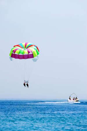 Leisure travelers to Parachute to the ocean resort Stock Photo