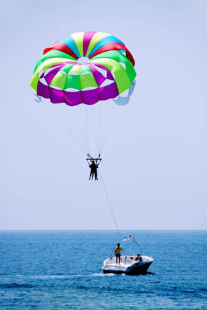 Leisure travelers to Parachute to the ocean resort Stock Photo