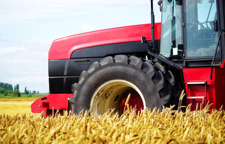 Tractor in a field, an exhibition of modern technology Stock Photo