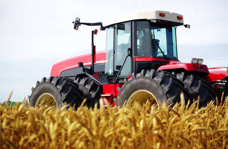 Tractor in a field, an exhibition of modern technology photo