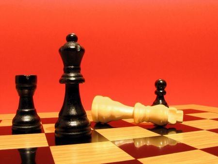 Chess board with pieces in checkmate position Stock Photo - 2480594