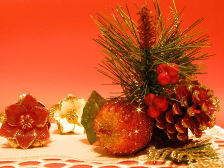 Christmas decorations opposite red background photo