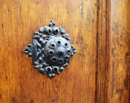 historic door knocker on wooden door Stock Photo