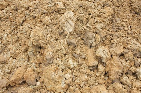 close up wet brown clay texture