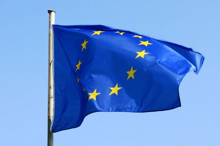 blue EU flag blowing in the wind photo