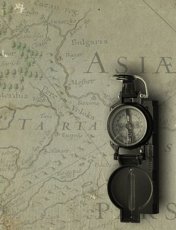 aged medieval map with compass photo