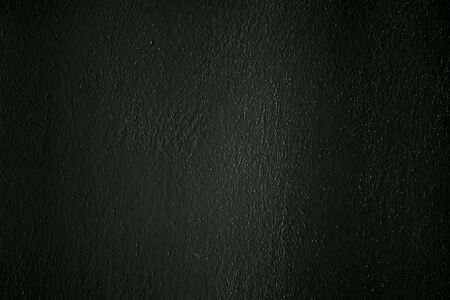 squalid: a dark concrete wall as a background