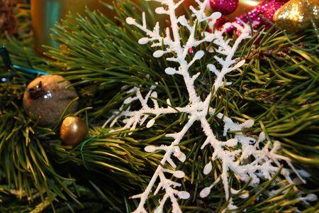 Christmas snowflake with green twig