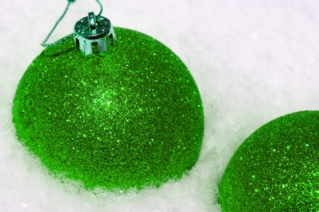 close up of green Christmas balls on white snow Stock Photo - 17638403