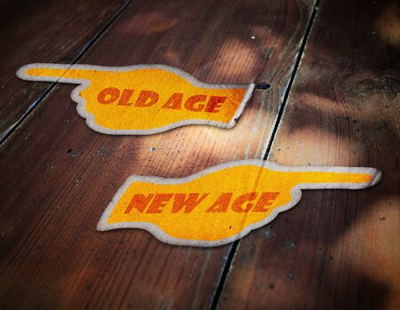 new age: dark aged vintage hand paper on wood; old age and new age way