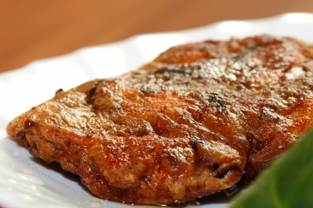close up of grilled beef steak on white plate