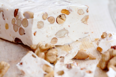 pieces of turkish delight nougat on desk Stock Photo
