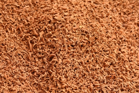 close up of small brown lactic chocolate shavings texture photo