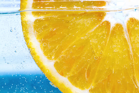 close up of lemon slice under water photo