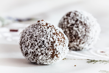 close up of Christmas chocolate shaped sphere sweets with coconut on table cloth photo