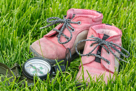 good direction - little baby booties in the grass with compass photo