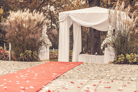 path to wedding ceremony marquee with petals, vintage picture Stock Photo