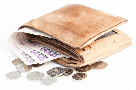 a close wallet with Czech money and coins on white background