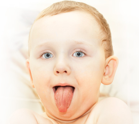 cute young children showing tongue; health-care theme - warm tone image look Stock Photo