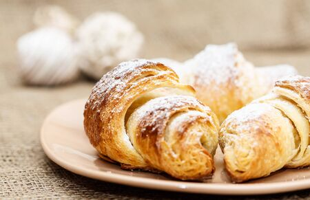 close up of three croissants on plate