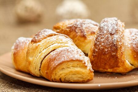 close up of fresh croissants on plate Stock Photo